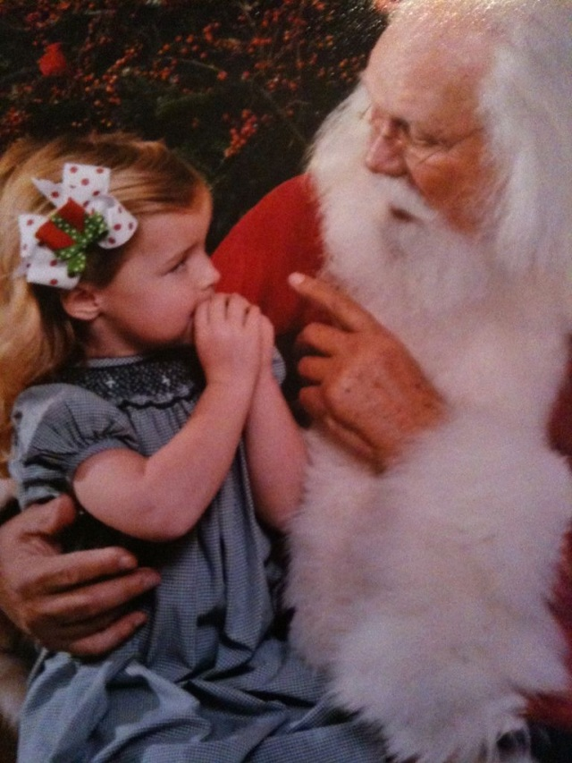 Little girl on Santa's Knee