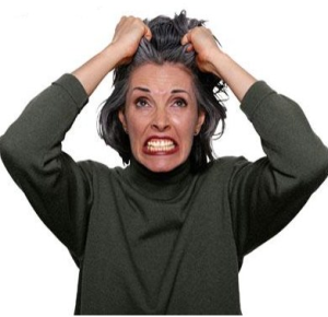 Woman tearing her hair out
