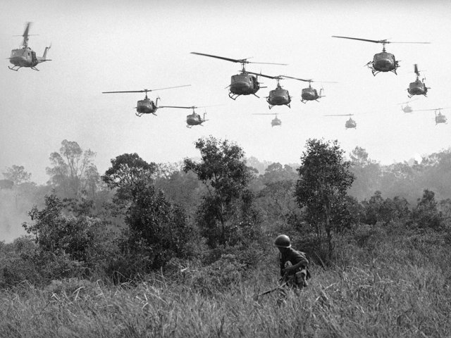us-army-helicopters-pour-machine-gun-fire-into-the-tree-line-to-cover-the-advance-of-vietnamese-ground-troops-in-an-attack-on-a-viet-cong-camp-on-march-29-1965